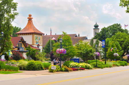 FRANKENMUTH, MI - JUNE 28, 2014: Bavarian-style architecture is one of the main attractions in this Michigan town known best for Christmas and German food. In view: the visitor center on Main Street.