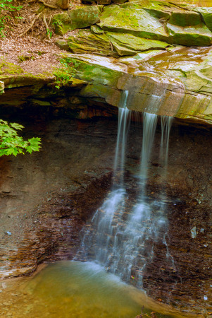 overhang: Blue Hen Falls in Cuyahoga Valley National Park, near Cleveland Ohio Stock Photo