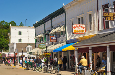 mackinac: MACKINAC ISLAND, MI - JUNE 26, 2014: Picturesque shops and attractions do a brisk business in summer in this popular tourist resort Editorial