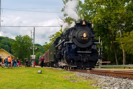 flashers: BRECKSVILLE, OH - SEPTEMBER 6, 2014: A passenger train pulled by the famous NKP-765 steam locomotive departs the Boston Mill station on the Cuyahoga Valley Scenic Railroad.