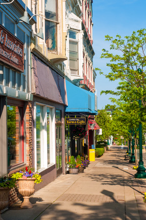 awnings: PETOSKEY, MI - JUNE 27: Shops and businesses along Mitchell Street (observer facing west) in Petoskey