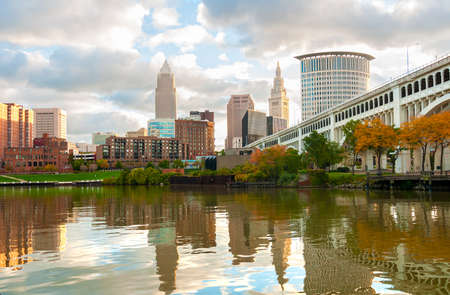 ohio: Downtown Cleveland Ohio rises above the Cuyahoga River at Heritage Park in morning light Stock Photo
