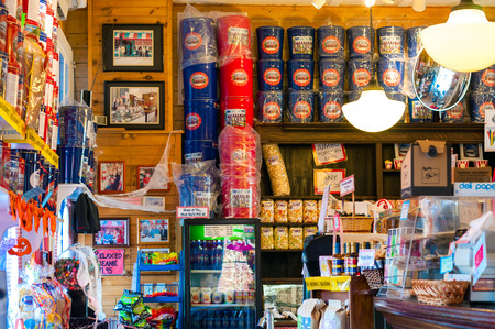 merchandise: CHAGRIN FALLS, OH - OCTOBER 26, 2014: The interior of the perennially popular Popcorn Shop gives conveys the look and feel of an old-time general store. Patrons can get many varieties of popcorn, ice cream, and other snacks. Editorial
