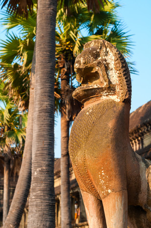 gouged: A lion statue stands guard outside the west gallery of the Angkor Wat temple in Siem Reap, Cambodia. Stock Photo