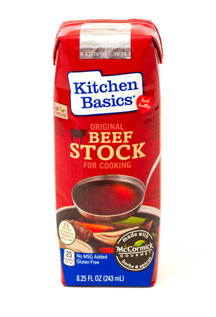 marketed: TWINSBURG, OH, USA - FEBRUARY 7, 2015: A package of Kitchen Basics Beef Stock on white. This beef broth is marketed as a heart-healthy option, being gluten free anc containting no MSG. Editorial