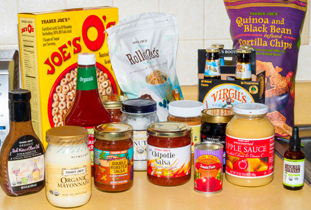 trader: TWINSBURG, OH, USA - JANUARY 17, 2015: An assortment of grocery products bearing the Trader Joe