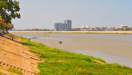 riverfront: PHNOM PENH CAMBODIA  MARCH 1 2014: The Tonle Sap River flows through Phnom Pehn at low stage dry season. The view here looks north not far from the confluence with the Mekong to the south. Editorial