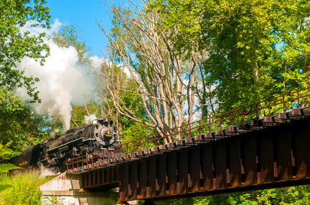 existence: PENINSULA OH  SEPTEMBER 14 2014: The NKP765 the largest steam engine in existence in the eastern US approaches a bridge on the Cuyahoga Valley Scenic Railroad. Running the steam train is an annual event.