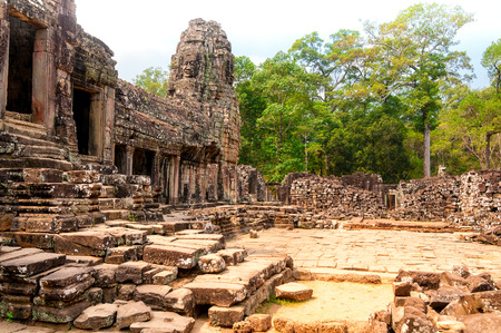 edifice: A courtyard of the Bayon temple at Angkor Wat Cambodia with the main edifice at left