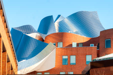 western usa: CLEVELAND, OH - FEBRUARY 28 2015: The Peter B. Lewis building, designed by renowned architect Frank Gehry, glistens in late afternoon sunlight. The building is on the campus of Case Western Reserve University.