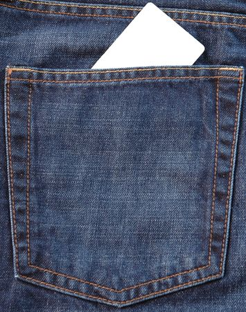 Blank card in jeans pocket on which you can write something photo