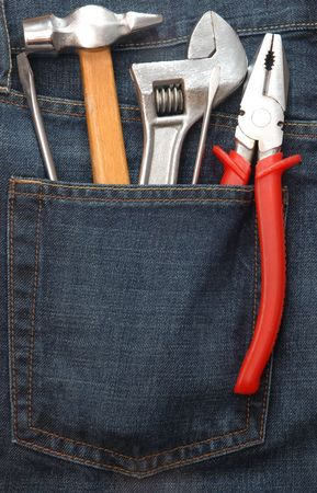 Toolkit of five items in a blue jeans pocket