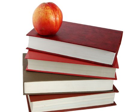 nectarine: books and nectarine isolated white Stock Photo