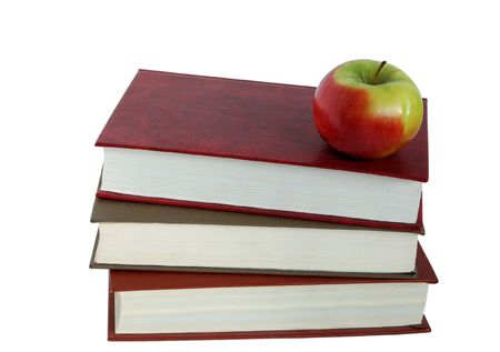 books and  an apple  isolated white