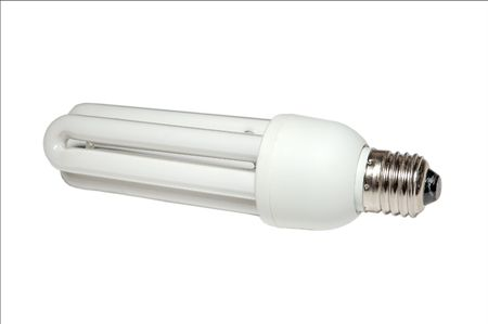 electrical fluorescent energy-saving lamp at white photo