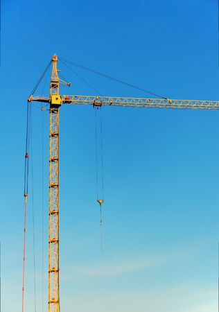 Lifting construction crane at blue sky Stock Photo - 630175