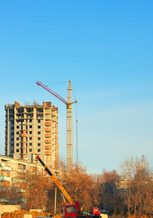 construction crane and  building at blue sky photo