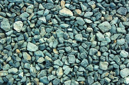 gravelly: small gray rugged crushed rocks background