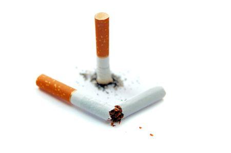 brand damage: Cigarette butt and broken cigarette isolated on white
