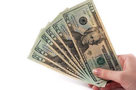 Dollar bankbiljetten in hand met kopie ruimte
