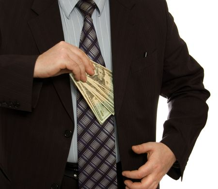 Businessman put money into pocket Stock Photo - 899148
