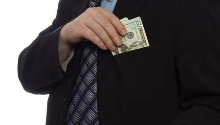 Businessman put money into pocket Stock Photo - 899149