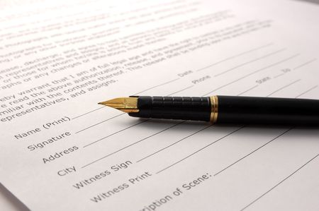 subscribing: signing a document Stock Photo