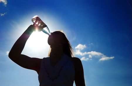 silhouette of girl drinking water outdoor Stock Photo - 1093333