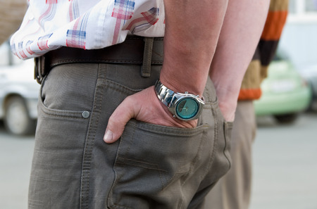 moneyless: hands in pokets concept