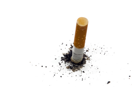 cancerous: Stop smoking background with copy-space - stub of cigarette with ash isolated on white