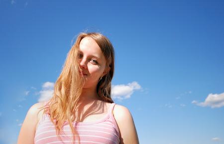 Girl over blue sky Stock Photo - 1490419