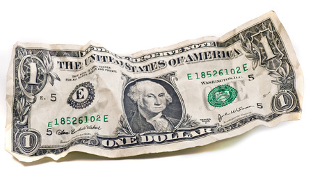 pay bill: one Crumpled dollar  Stock Photo