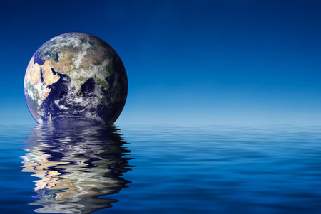 horizon reflection: Earth like planet rise over ocean Stock Photo