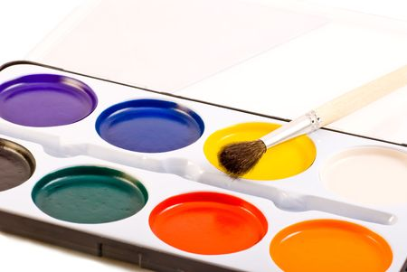 children water paints set and brush isolated on white photo