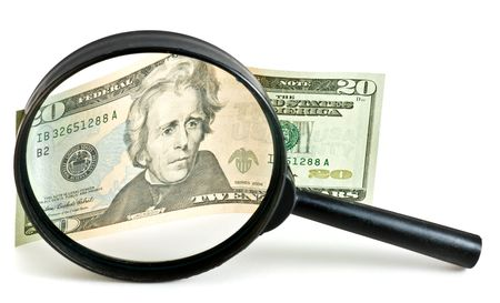 Dollar bill under magnification glass - businnes concept. photo