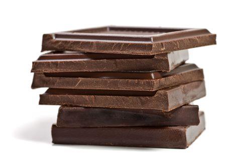 おいしいチョコレートをクローズ アップ ホワイト上分離