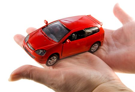 car automobile model in hand isolated on white photo