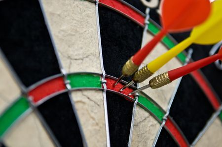 darts flying: Triple hit point in darts Stock Photo