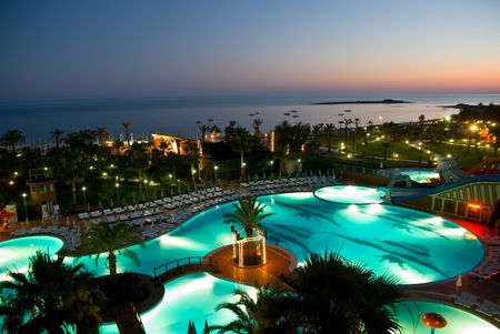 luxury hotel with pool at night