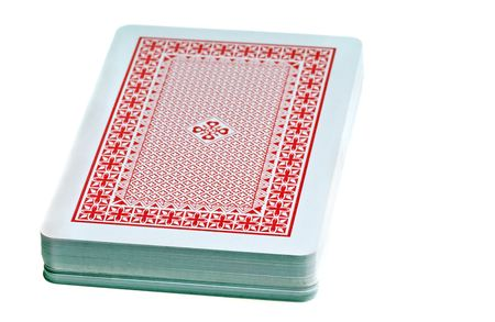 desk stack of playing cards isolated on white