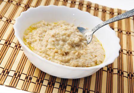 porridge: Hot morning porridge witn spoon.