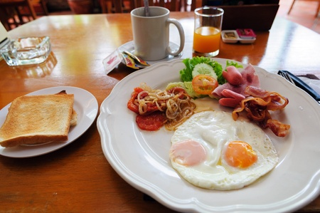 american breakfast on a table in Thai cafe photo