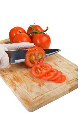 ingradient: Chopping tomato on kitchen board