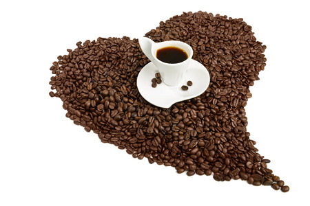 coffe beans: coffe cup on heart shape coffee beans Stock Photo