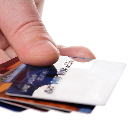 unreadable: A hand with unreadable credit plastic card Stock Photo