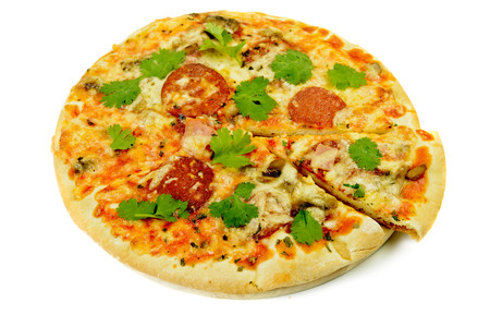 thinly: Mini thinly sliced pepperoni pizza with herbs isolated on white Stock Photo