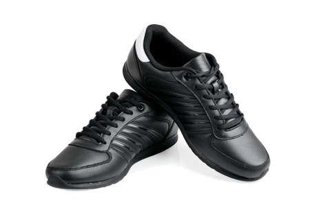 amarillo y negro: Los zapatos deportivos aislados en blanco