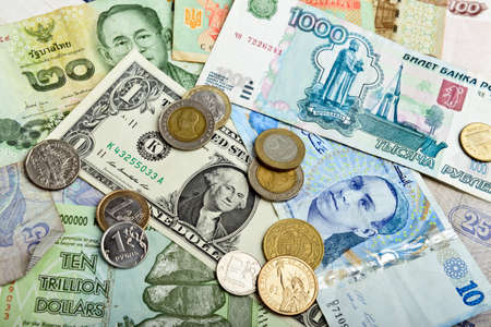 global currencies: Collection of various money to background Stock Photo