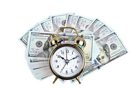 daylight: Alarm clock on money background