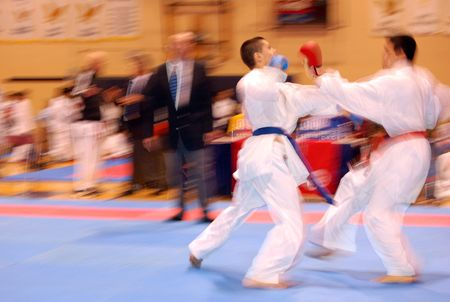 Attack in karate combat photo